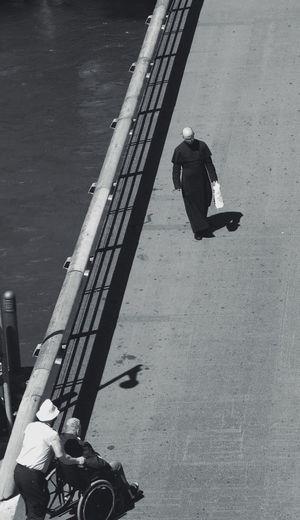 Men On Footbridge