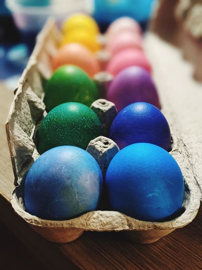Close-up of multi colored eggs on table