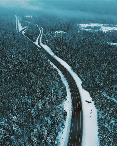 High Angle View Of Road On Snow Covered Landscape