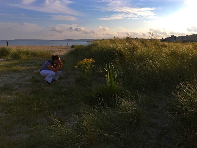 Grass Nature Sky Leisure Activity Cloud - Sky Vacations Tranquil Scene Sea Photographing Summer Lovecornwall Outdoors Beauty In Nature Tranquility Mature Adult Scenics Real People One Person Full Length Beach Marram Grass Growth