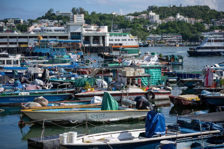 Fishing boats moored at harbor