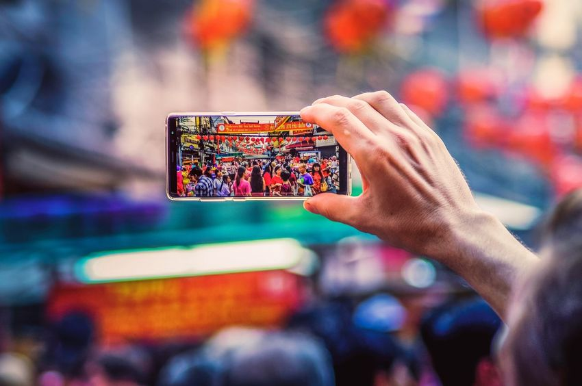 Chinese New Year in Bangkok Phone ASIA Chinese New Year 2018 Chinese New Year Chinatown Thailand Bangkok Arts Culture And Entertainment Human Body Part Focus On Foreground People Wireless Technology Excitement