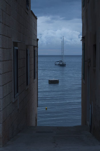 Clouds Close To Horizon Evening Blue Sky Fisherman's Town Intense Blue Narrow Alleys Sailling Boats Ancored Stone Houses  Street To The Sea