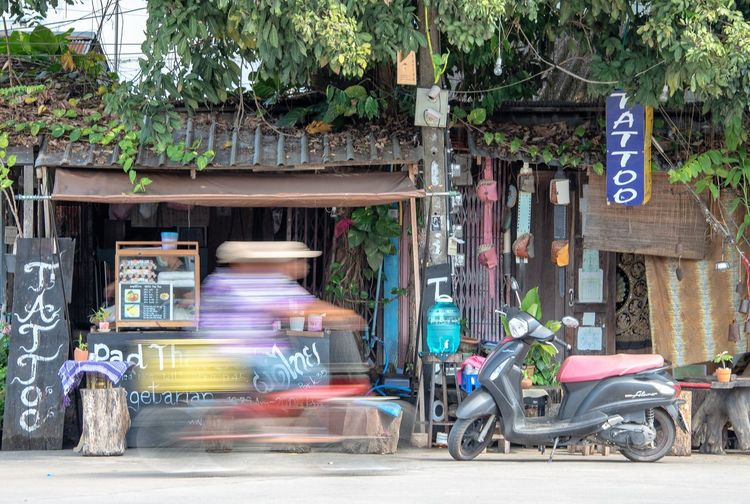 Blurred Motion Transportation City Motion Street Mode Of Transportation Road Architecture Day Tree Rickshaw Land Vehicle on the move Text Outdoors People Building Exterior Communication Speed Incidental People Thailand Travel Destinations Travel Photography Thailandtravel