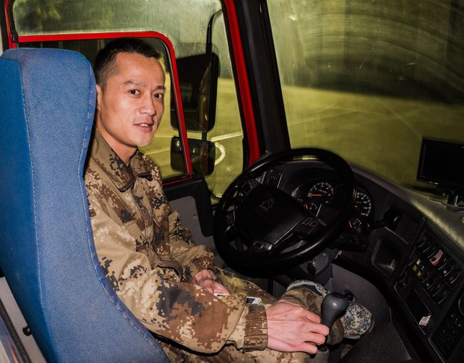 Portrait Looking At Camera One Person Smiling Car Adults Only Cheerful Occupation One Man Only Night Working Only Men People Military Adult Army Soldier Military Uniform Army Outdoors