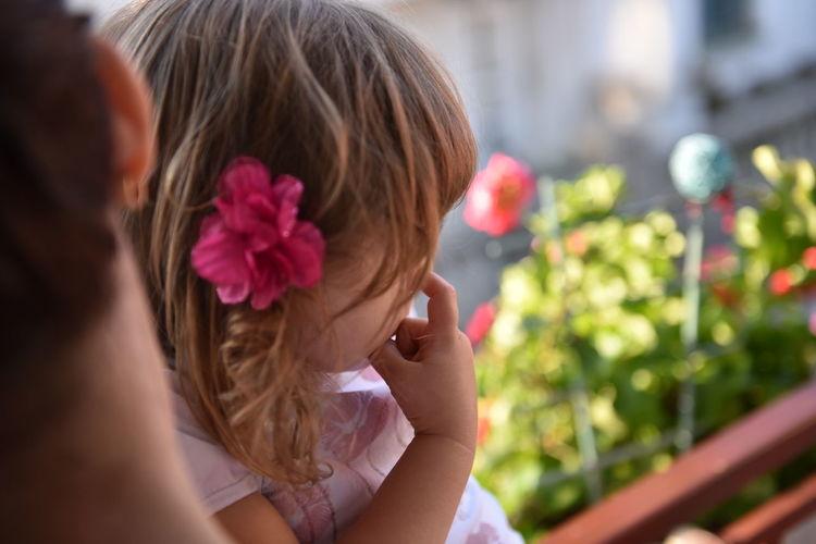 Close-up of girl picking nose