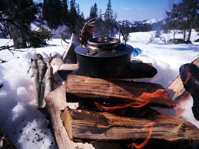 Outdoors Tree Day Nature Sky No People Fire Kettle Coffee Exploring Trekking Bonfire Skiing Snow Sun Calm Making coffee on the fire - outdoors recreation in Norway. Be. Ready.