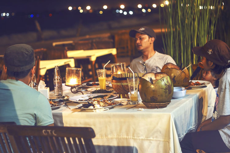 Dinner at Jimbaran, Bali, Indonesia Bali, Indonesia INDONESIA Day Dining Table Eating Food Food And Drink Freshness Friendship Indoors  Jimbaran Beach Leisure Activity Lifestyles Men People Plate Restaurant Sitting Table Togetherness Wineglass Women Young Adult Young Men Young Women