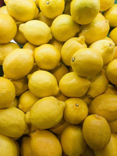 Full frame shot of lemons in market