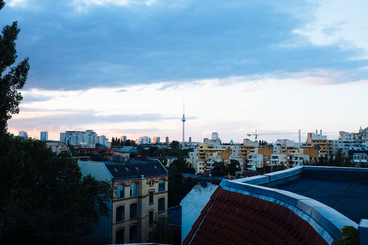 Distant View Of Fernsehturm In City Against Sky