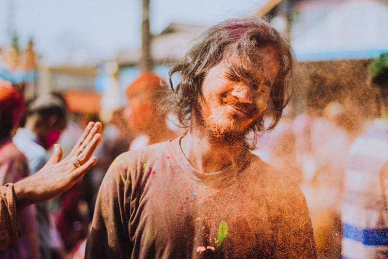 Portrait of young man during holi.