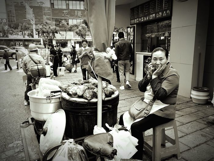 The Street Photographer - 2017 EyeEm Awards Women Outdoors Sitting Food Lifestyles Large Group Of People Adults Only Day City IPhoneography Smiling Monochrome Blackandwhite Happiness The Human Condition Sitting