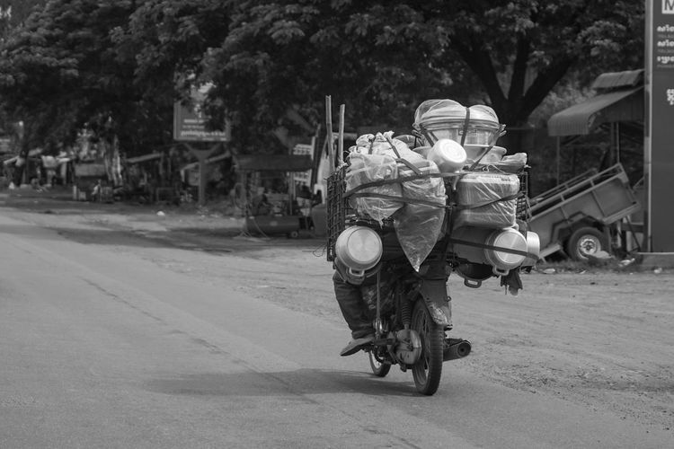 Man carrying luggage on motorcycle