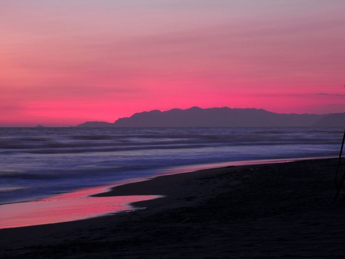 Lucca Lucca Italy Lucca Italy Beauty In Nature Sea Water Sunset Scenics - Nature Land Sky Beach Mountain No People Nature Idyllic Orange Color Pink Color Romantic Sky