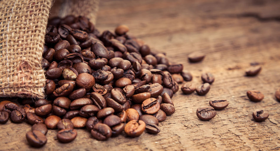 Fine roasted coffee beans Coffee Coffee Beans Coffee Break Coffee Crop Coffee Time Coffee ☕ Copy Space Fair Trade Fresh Roasted Coffee Text Space Wooden Background