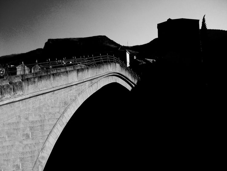 Old bridge in Mostar Arch Architecture Black And White Photography Bosnia And Herzegovina Bridge - Man Made Structure Built Structure Chain Bridge Clear Sky Connection Day Destroyed Buildings Mostar Mountain No People Old Bridge Mostar Outdoors Silhouette Sky Transportation Travel Travel Destinations War