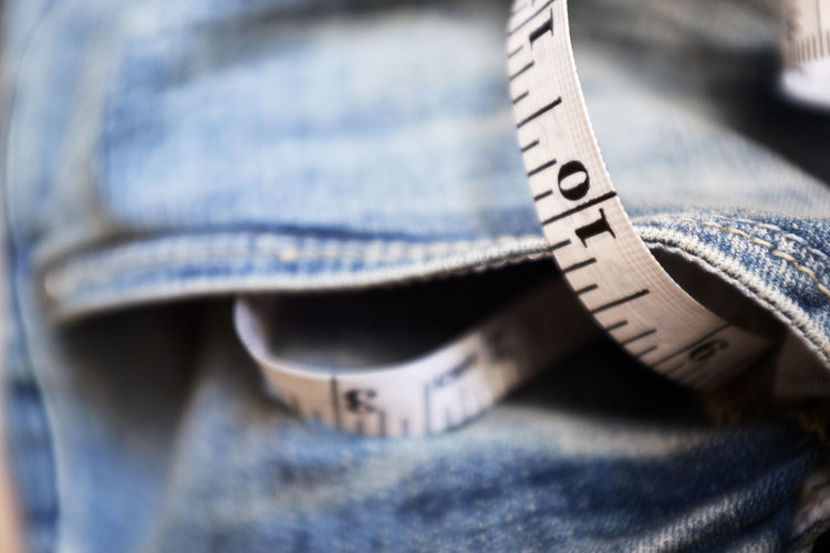 Accuracy Blue Jeans Close-up Day Extreme Close-up Focus On Foreground Fujifilm X100f Fujifilm_xseries High Angle View Indoors  Instrument Of Measurement Jeans No People Number Ruler Selective Focus Simplicity Single Object Still Life Tape Measure Textile Textile Industry 10 The Still Life Photographer - 2018 EyeEm Awards The Fashion Photographer - 2018 EyeEm Awards