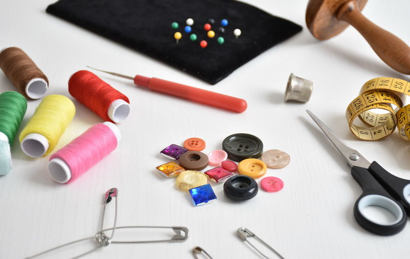 Close-up of sewing items on table