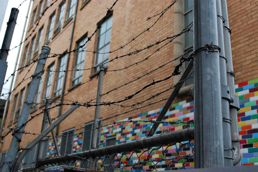 Architecture Building Exterior Built Structure Bricks Coloured Bricks Wire Fence Wire Fence Close Up, Barbed Wire Prison Locked Out Keep Out Melbourne City Melbourne Nikonphotography Nikon St Kilda The Week On EyeEm