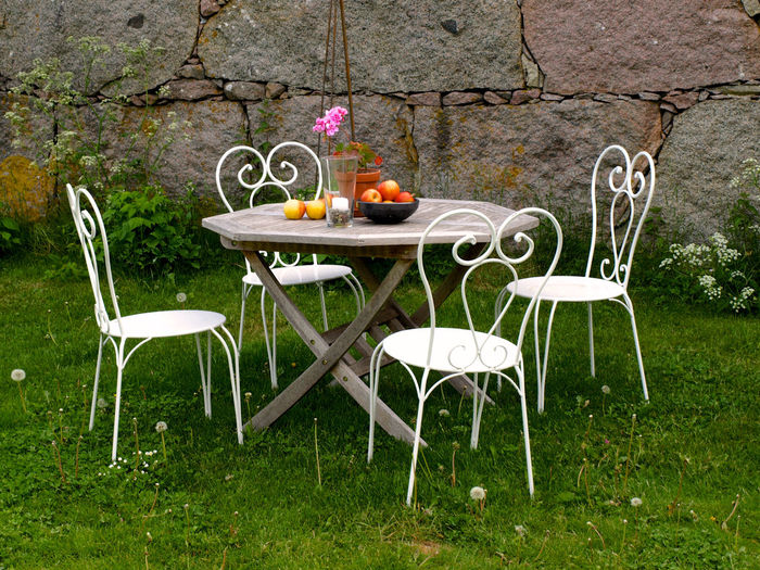 Table and chairs in yard