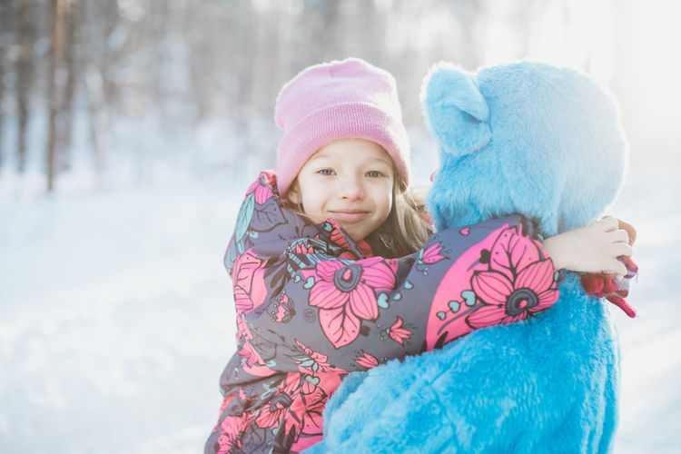 Little girl in a winter suit and her imaginary friend, the blue bear Bear Family Wintertime Blue Bonding Childhood Cold Temperature Imaginary Imaginary Friend Kid Little Girl Outdoors Snow Two People Warm Clothing Winter
