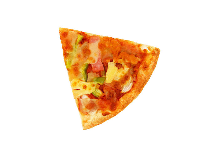 Close-up of pizza on white background