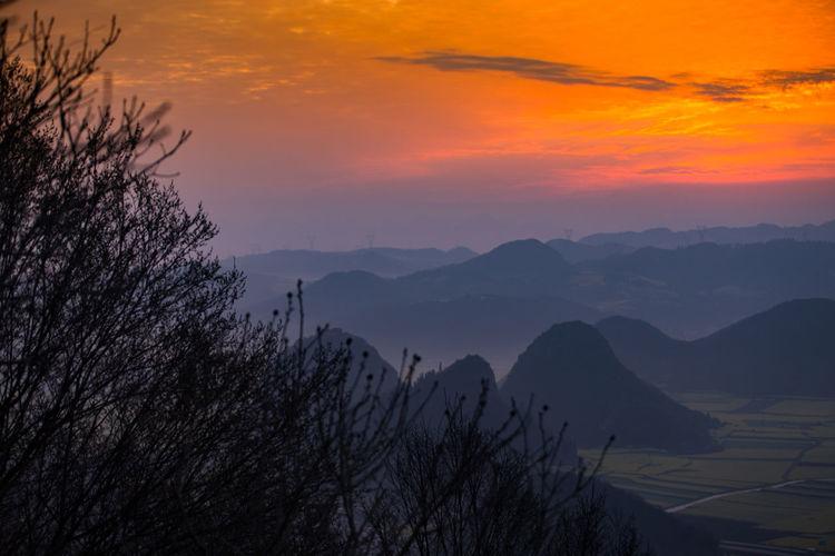 Sky Scenics - Nature Sunset Beauty In Nature Mountain Tranquility Tranquil Scene Tree Plant Orange Color Nature Cloud - Sky Idyllic No People Mountain Range Non-urban Scene Environment Landscape Outdoors Mountain Peak