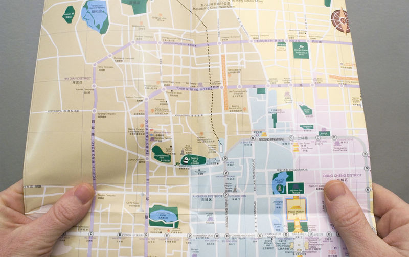 holding beijing city map City Map From My Point Of View Map Touring Tourist Traveling Above View Chart Close-up Communication Consulting Decision Direction Exploration Guidance Holding Human Finger Human Hand One Person Real People