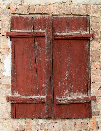 Full frame shot of red door on brick wall