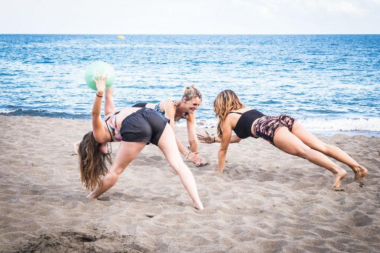 Females exercising on sand