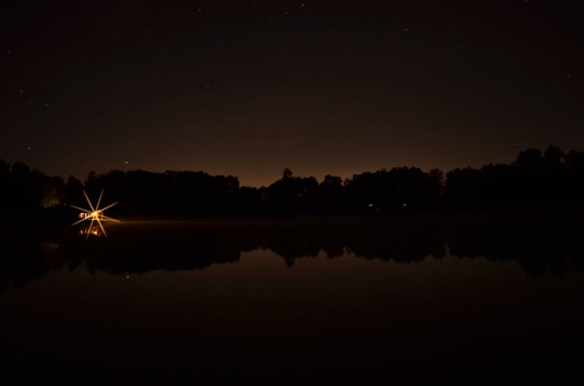 Beauty In Nature Illuminated Lake Nature Night No People Reflection Scenics - Nature Silhouette Sky Star - Space Tranquil Scene Tranquility Water