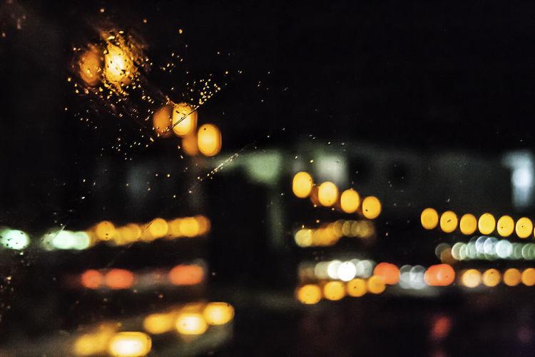 Car Lights Rain RainDrop Street Light Water Reflections Bokeh Bokeh Photography Car Car Window Defocused Drop Glass - Material Illuminated Night No People Outdoors Rain On Car Rain On Car Window Rain On Window Rainy Season Selective Focus Water Wet Window Windshield