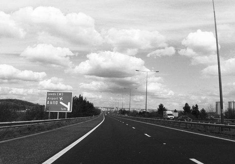Asphalt Black And White Blackandwhite Cloud Cloud - Sky Cloudy Day Diminishing Perspective Directional Sign Empty Empty Road Highway Information Sign Landscape Long Nature No People Outdoors Overcast Road Road Marking Road Sign Sky The Way Forward Vanishing Point