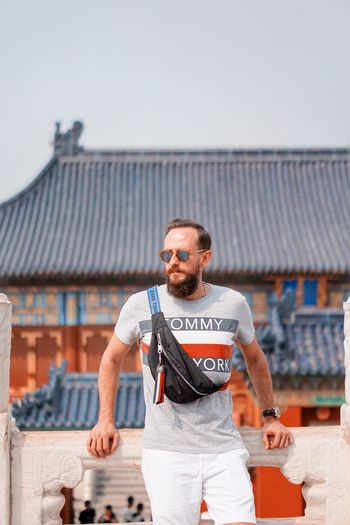 One Person Beard Facial Hair Architecture Building Exterior Men Adult Front View Fashion Copy Space Mid Adult Focus On Foreground Standing Day Portrait Roof Built Structure Casual Clothing Three Quarter Length Outdoors