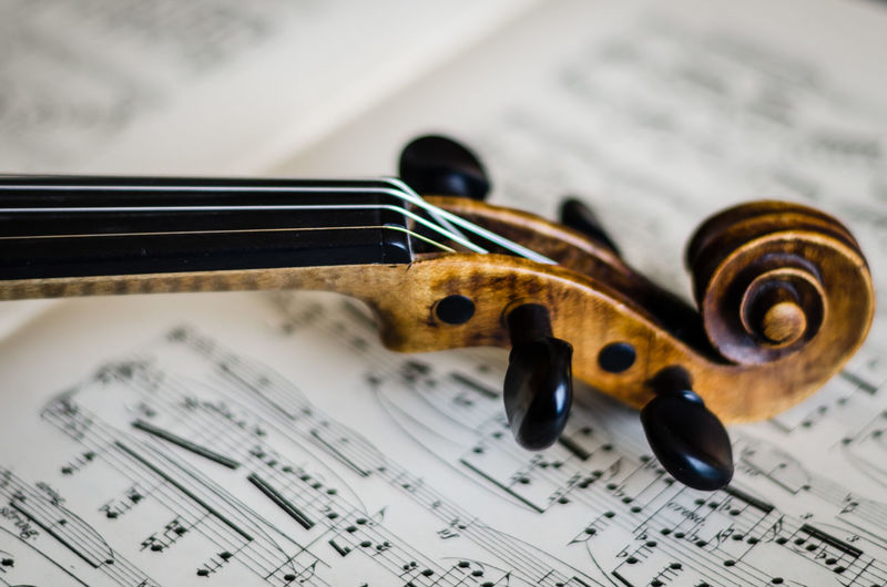 Arts Culture And Entertainment Classical Music Close-up Day Focus On Foreground Fretboard Guitar Indoors  Music Musical Equipment Musical Instrument Musical Instrument String Musical Note No People Paper Selective Focus Sheet Music Still Life String Instrument Violin Woodwind Instrument