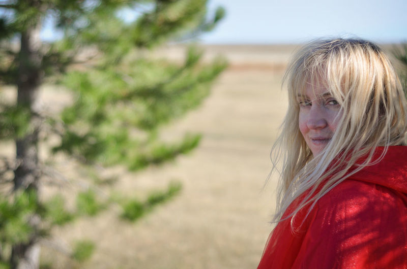Blond Hair One Person Portrait Red Focus On Foreground Adult Headshot Beautiful Woman Looking Long Hair Red Riding Hood Tree Plains Prairie Rural Scene Outdoors Fantasy Hair Eyes Watching Follow Drama Woman Girl Land