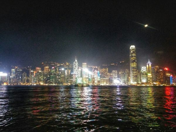 The Moon, she hangs like a cruel portrait Soft winds whisper the bidding of trees HongKong Cityscape City Lights Moon Night Lights Water Reflections Cities At Night