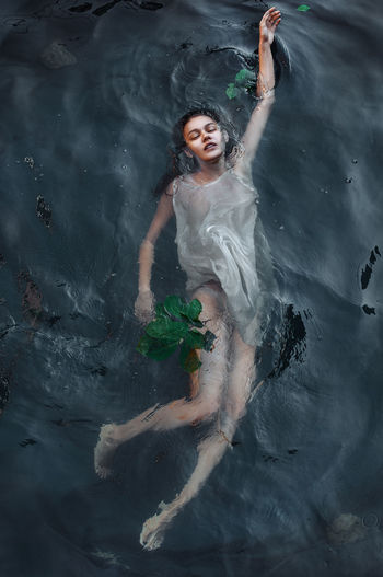 Portrait of a young woman in water