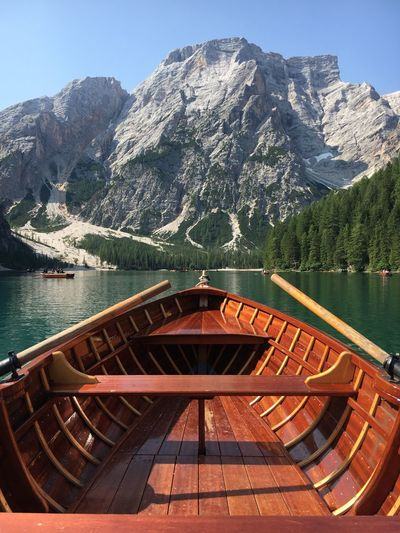 Romantic rowing boat trip on the beautiful braies lake  in the dolomites region, italy.