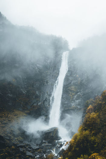 impressive waterfall in Switzerland Fog Scenics - Nature Beauty In Nature Nature No People Mountain Waterfall Non-urban Scene Water Rock - Object Power In Nature Flowing Water Outdoors Autumn Power Foggy Rock Rock Formation Switzerland Mist Mood Moody Sky