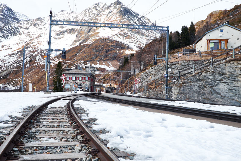 Snow Cold Temperature Winter Transportation Railroad Track Building Exterior Tree Day Outdoors Rail Transportation Architecture No People Nature Sky Railway Station Station Bernina Express Switzerland Swiss Alps Landscape