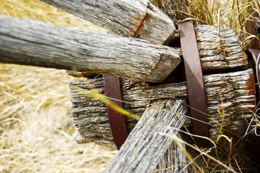 Wagon wheel spokes Outdoors North Of Douglas Wyoming Abandoned Deteriorated Junkyard Rusted Old Weathered Metal Weathered Wood Wood - Material Close-up Worn Out Obsolete Discarded