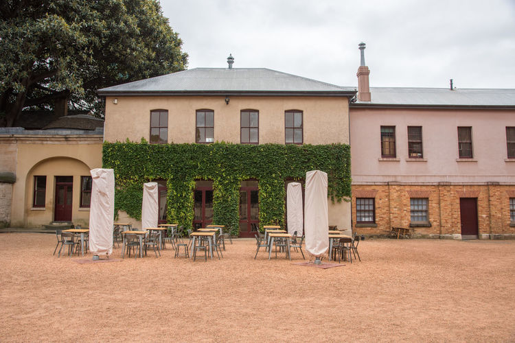 Sydney,NSW,Australia-November 19,2016: Hyde Parks Barracks Museum courtyard with ivy and seating in Sydney, Australia. Architecture Australia Chair Plant Tourist Attraction  UNESCO World Heritage Site World Heritage Alfresco Barracks Brick Building Exterior Convict Courtyard  Dining Historic Hyde Park Barracks Ivy Museum Queen's Square Site Sydney Table Tourism Vine