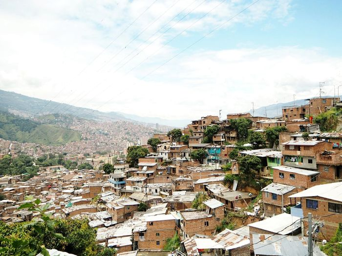 Medellin Colombia Poverty City Cityscape Town City Cityscape Mountain Sky Architecture Building Exterior Cloud - Sky TOWNSCAPE Housing Settlement Crowded Residential District Human Settlement Rooftop