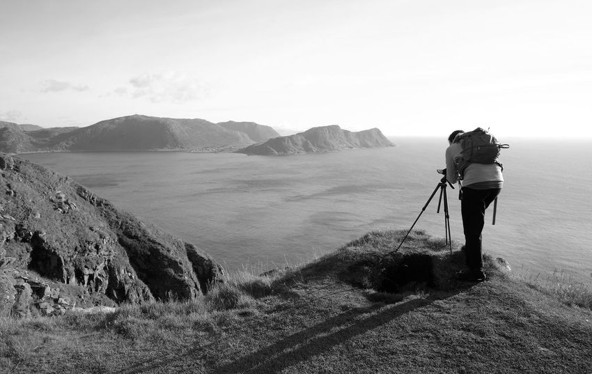 Photographer in nature (Norway) Black & White Exploring Nature Norway Scandinavia Adult Beauty In Nature Blackandwhite Camera - Photographic Equipment Explore Island Landscape Leisure Activity Lifestyles Mountain Nature One Person Outdoors People Photographer Photography Photography Themes Runde Scenics Travel Destinations