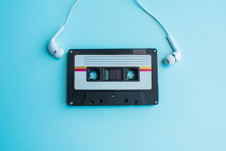 Tape Cassette Retro Old Vintage Technology Colored Background Blue Indoors  Studio Shot Communication Blue Background Close-up No People Connection Directly Above Single Object Wireless Technology Music Copy Space Device Screen Table Portable Information Device Retro Styled Turquoise Colored Electrical Equipment