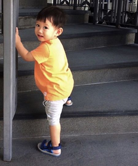 Full Length Childhood Child One Person Real People Innocence My Best Photo Looking At Camera Portrait Cute Casual Clothing Males  Standing Boys Leisure Activity Staircase Lifestyles Day Baby Outdoors