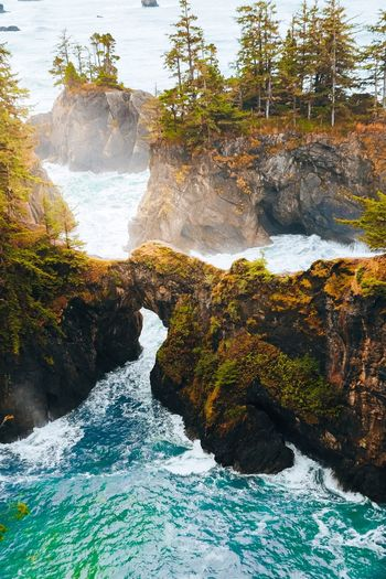Nickverbelchuk.com | @snickersv Water Nature Rock Beauty In Nature No People Rock - Object Solid Day Sunlight Outdoors Motion High Angle View Scenics - Nature Sea Land Splashing Reflection Beach Tranquility Flowing