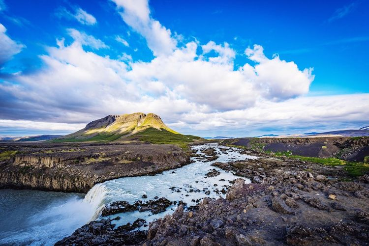 One of thousands of waterfalls in Iceland. Waterfall Iceland EyeEm Best Shots Sky Cloud - Sky Beauty In Nature Blue Nature Day Scenics Mountain Rock - Object Outdoors No People Water Landscape The Great Outdoors - 2018 EyeEm Awards