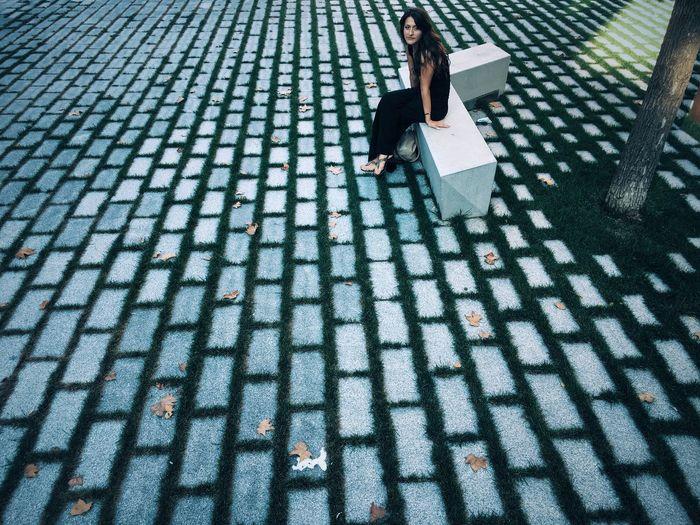 Woman walking on zebra crossing